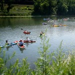 People in kayaks, canoes and other floating devices congregate near the Dunn Field Boat Launch in Elmira prior to the start of the Chemung River Run on Saturday.