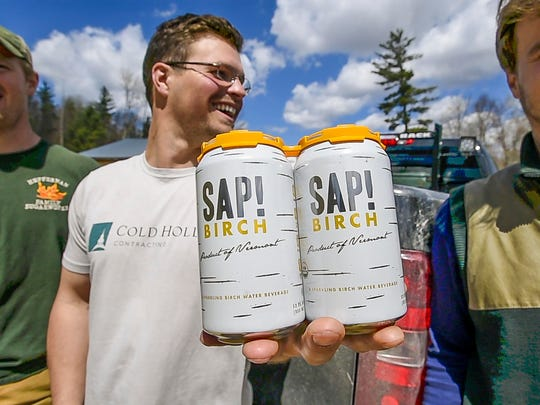 Brian Heffernan of the Heffernan Family Sugarworks in Starksboro, left, with Nikita Salmon, center, and Chas Smith of Sap!, a Middlebury-based maple beverage company, on Thursday, April 28, 2017.  Sap! makes birch sparkling water made from sap sourced in part from Heffernan's birches.
