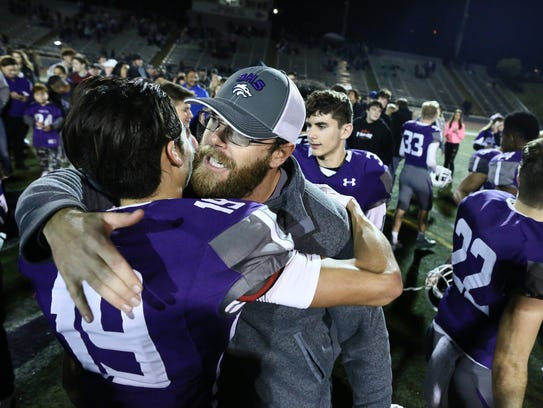 Shasta head coach J.C. Hunsaker is congratulated by