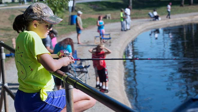 Kelsea Storm, of Wrightsville, catches fish on Kiwanis Lake during a fishing derby sponsored by the York-Adams County Central Labor Council during York Labor Day at Kiwanis Lake.