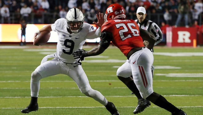 Penn State quarterback Trace McSorley (9) tries to get away from Rutgers linebacker Deonte Roberts (26) during the first half of an NCAA college football game Saturday, Nov. 19, 2016, in Piscataway, N.J.