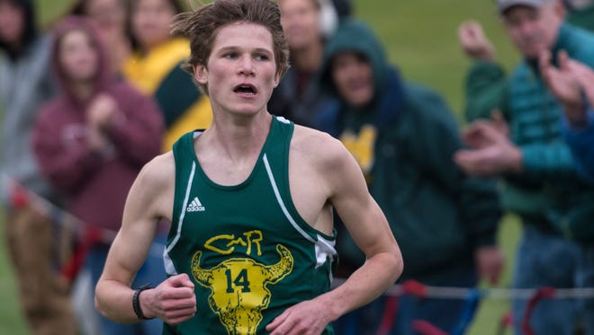C.M. Russell High's Cooper West won the championship last month at the Class AA state cross country meet.