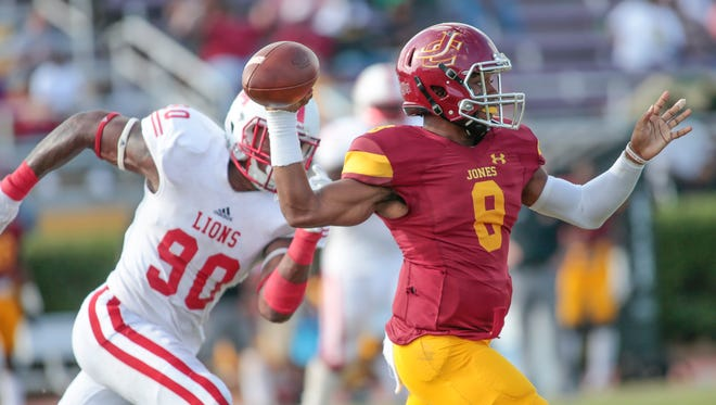 JCJC quarterback Detric Hawthorn (8) throws the ball as East Mississippi's Lorenzo Dantzler (90) moves in during Saturday's game.