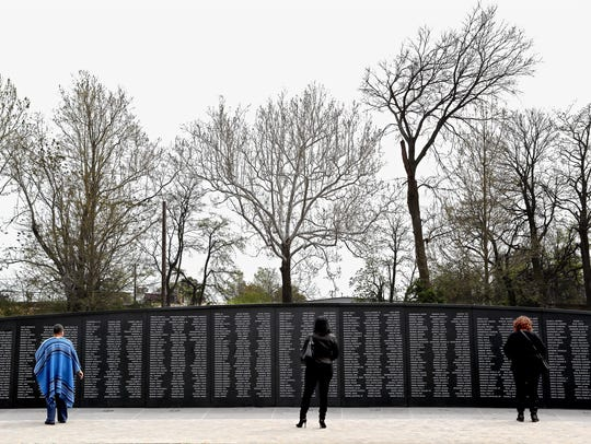 April 5, 2018 - Visitors read the engraved names of