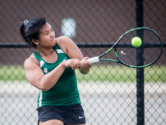 Yorktown's Samantha Academia returns a hit from Central's