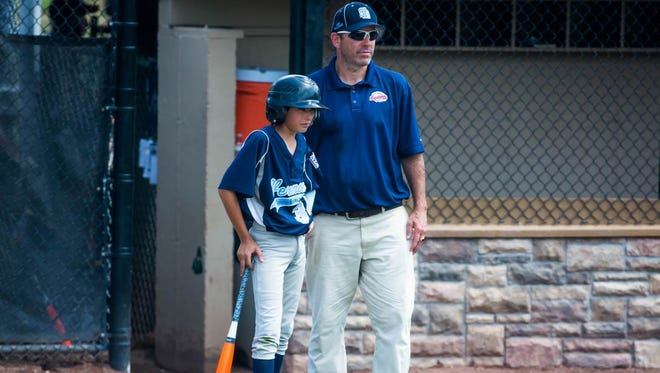 South Burlington's 11- and 12-year-old Little League coach Sean McGrath, seen during the 2015 New England regional tournament in Bristol, Connecticut, was suspended for this year's state tournament for breaking a player participation rule in a District I contest last week.