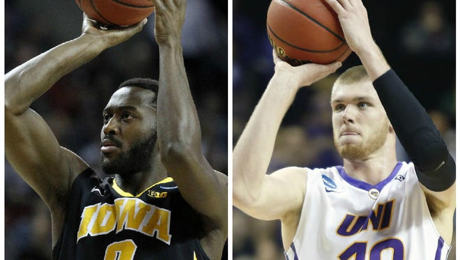 Former Iowa basketball player Gabe Olaseni and Northern Iowa's Seth Tuttle signed with the Miami Heat as free agents.