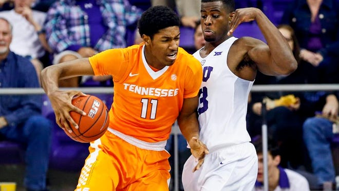 Tennessee Volunteers forward Kyle Alexander (11) dribbles as TCU Horned Frogs forward Chris Washburn (33) defends during the first half at Ed and Rae Schollmaier Arena on Jan. 30, 2016.