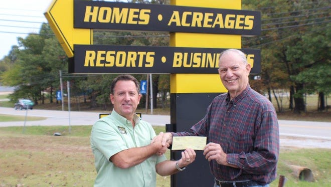 Gary Stubenfoll (left), owner of Beaman Realty, presents a $500 donation to Gerry Jacobs, Bull Shoals TeleCare Board vice president. Bull Shoals TeleCare is a free volunteer service which provides daily phone calls to residents of Baxter and Marion counties who live alone to help them remain independent. Volunteers provide assurance and conversation 365 days a year. For information, call (870) 445-3110 and leave a message, a volunteer will return the call.