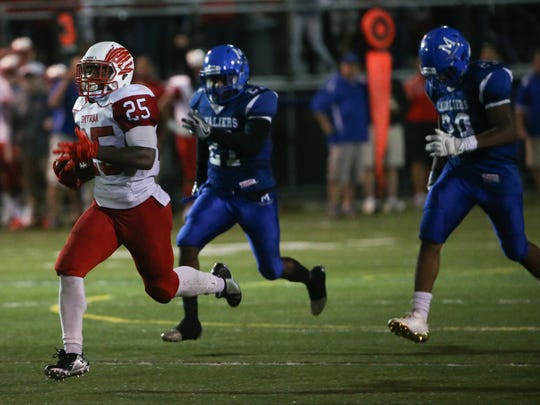 Smyrna's Will Knight (25) outruns the Middletown defense for a 70-yard score on Sept. 8. Knight passed 5,000 career yards against Cape Henlopen last Friday.