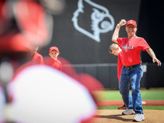 Fritz Esser hows out the first pitch before the game between Louisville and Virginia.