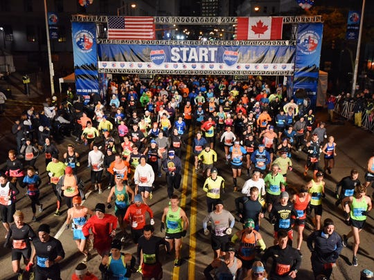 Runners start the 2015 Detroit Free Press/Talmer Bank Marathon Sunday, October 18, 2015 in downtown Detroit.