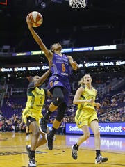 Phoenix Mercury guard Yvonne Turner (6) is fouls by Seattle Storm guard Alexis Peterson (2) as she goes up for a layup during the first half of their WNBA game Sunday,  May 7, 2017 in Phoenix, Ariz.