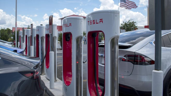 A Tesla Supercharger station with 14 bays is shown on June 23 in Jacksonville, Fla.