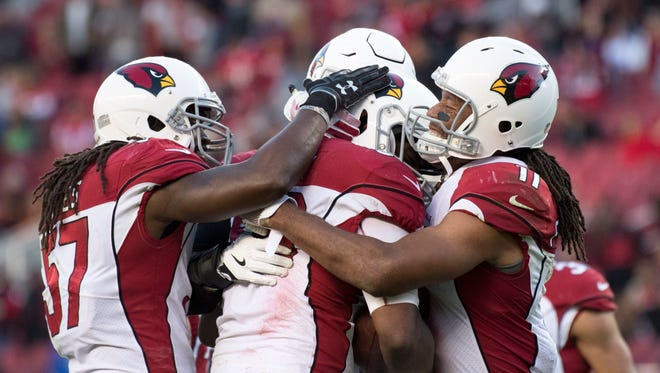 November 5, 2017: Arizona Cardinals wide receiver Larry Fitzgerald (11) congratulates inside linebacker Karlos Dansby (56) on an interception against the San Francisco 49ers during the fourth quarter at Levi's Stadium. The Cardinals defeated the 49ers 20-10.