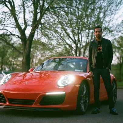 D.H. Goodall stands with his 2017 Porsche 911.
