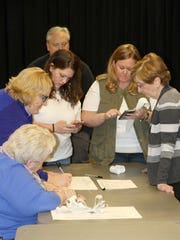 Members of the Election Board and Town of Middletown election officials tally up the votes Monday night after the polls closed in Middletown. From left are: Lorraine Reeves, Kristen Krenzen, Kiley Edwards, Ray Hudson, Megan McGhee and Sonya Comstock.