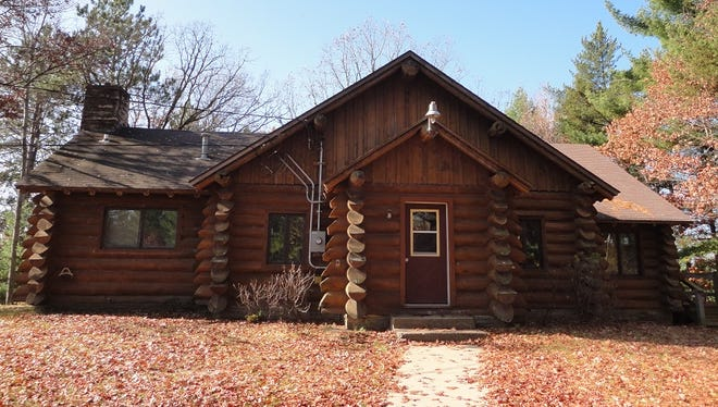 This log cabin was the first building at YMCA Camp Alexander. Logs from the site were used and parents of campers assisted in the building under the direction of architect Donn Hougen.