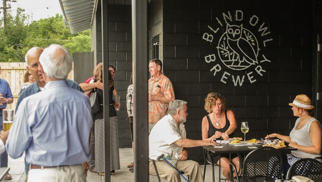 Shaded areas with tables are available at the Bier Garten at Blind Owl Brewery.