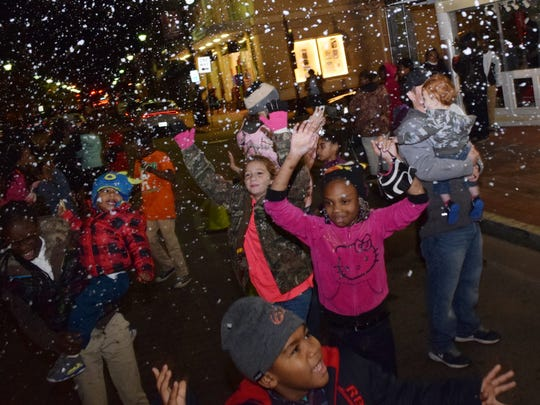 """Children enjoy a snowfall created by snow machines at Alex Winter Fete in early December. Not only did the downtown Alexandria festival draw larger-than-expected crowds, it was a reminder of """"what this community can do when it comes together and how wonderful and beautiful this community is,"""" Mayor Jacques Roy said."""