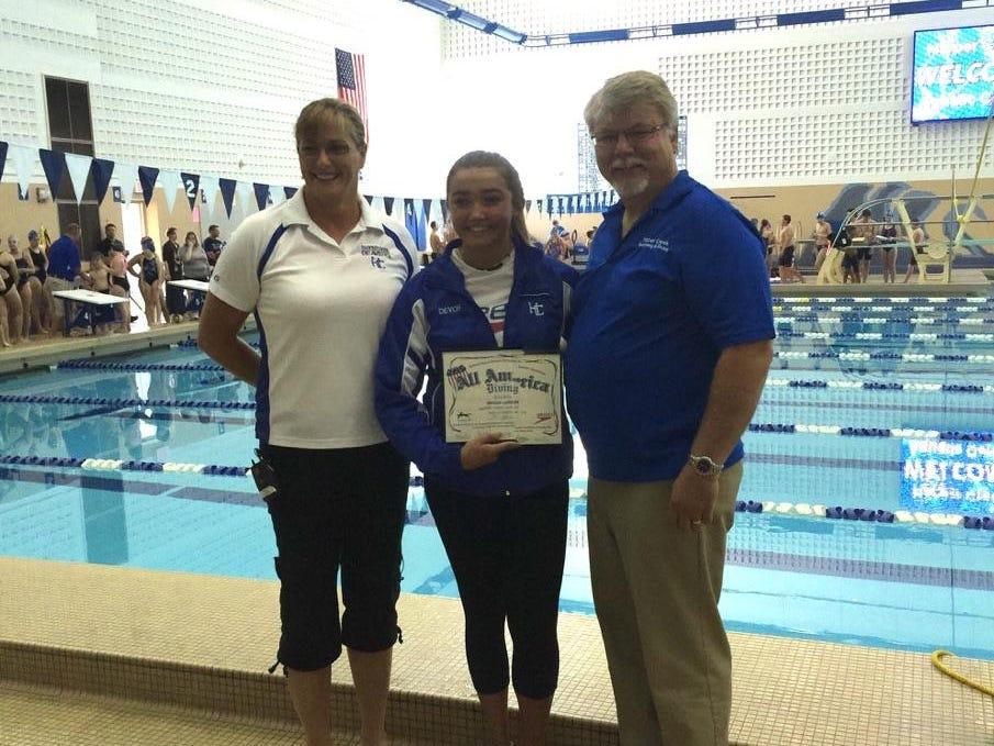 Harper Creek's Devon Larson, center, has been named to the 2014-15 NISCA/ Speedo Girls 1-meter All-American Team.