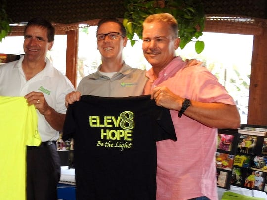 """From left, Elev8hope board members David Guizerix, Dr. Brian Moriarty, and Ronnie Kirchman talk about their organization.  Photo credit 3: Jamie Burns Photo caption 3: Carebag Founder & CEO Rozanne """"Roxy"""" Brown, Santa Clause, Deni Horna"""