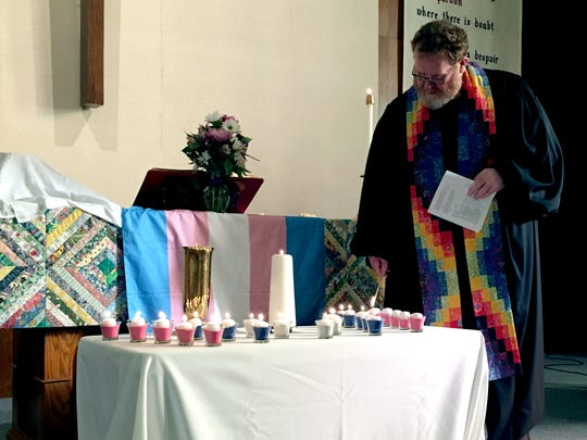 The Rev. John Fiscus lights candles during a vigil in honor of the Transgender Day of Remembrance at Peace United Church of Christ on Sunday, Nov. 19, 2017. Each candle represented a transgender person killed in the U.S. in 2017.