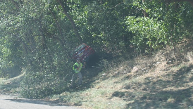A car is in the woods off of Route 287 south near mile marker 51 in Pequannock as police investigate on Saturday, Sept. 23, 2017.