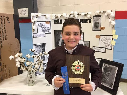 Camden White with his first place ribbon and plaque. White posed as and researched Eli Whitney.
