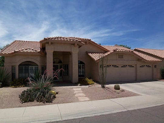 Four bedrooms, two bathrooms, one story, granite kitchen counters, built-in desk, fireplace, wet bar, vaulted ceilings, garage-attic storage with pull-down ladder and diving pool with updated pool pump.