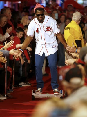 Reds second baseman Brandon Phillips walks down the aisle as he is introduced at Redsfest, Friday, Dec. 4, 2015, at the Duke Energy Convention Center in Cincinnati. Redsfest will be open 11 a.m. to 6:30 p.m. Saturday. ItÕs the official annual winter warmup of Major League BaseballÕs oldest team.