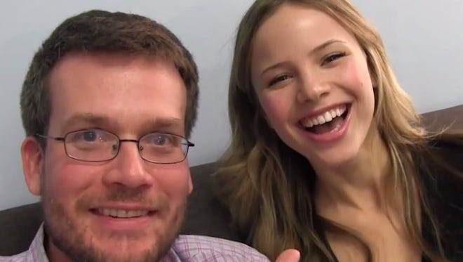 """John Green and actress Halston Sage are seen in one of Green's """"Vlogbrothers"""" YouTube videos."""