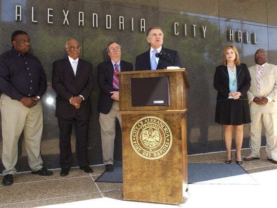 In this April 2006 photo, Alexandria Mayor Ned Randolph (center, foreground) is flanked by city council members and his wife Deborah as he announces he will not seek a sixth term as mayor.