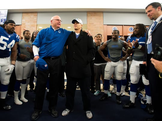 Indianapolis Colts interim head coach Bruce Arians, left, and head coach Chuck Pagano embrace in the locker room after the Colts defeated the Miami Dolphins 23-20 Nov. 4, 2012.