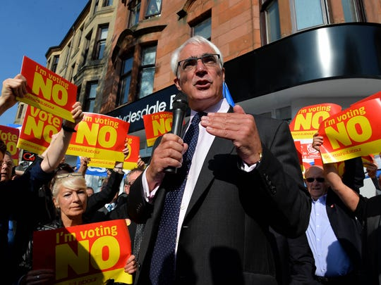 "GLASGOW, SCOTLAND - SEPTEMBER  10:   Alistair Darling MP campaigns for a ''No'' vote in the referendum on Rutherglen main street on September 10, 2014 in Glasgow, Scotland. The three UK party leaders are all campaigning in Scotland today showing their support for a ""No"" vote in the independence referendum.  (Photo by Mark Runnacles/Getty Images) ORG XMIT: 512063605 ORIG FILE ID: 455144614"