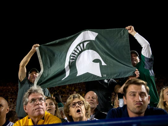Michigan State fans celebrate a Spartan touchdown during