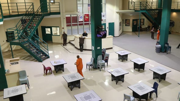 Inmates in orange are not veterans but are housed in