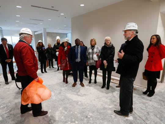 Doug Sampson, right, Missouri State University architect and director of planning, design and construction, leads a tour group through the Taylor Health and Wellness Center at Missouri State University, which will be done by Feb. 1 and is expected to open after spring break.