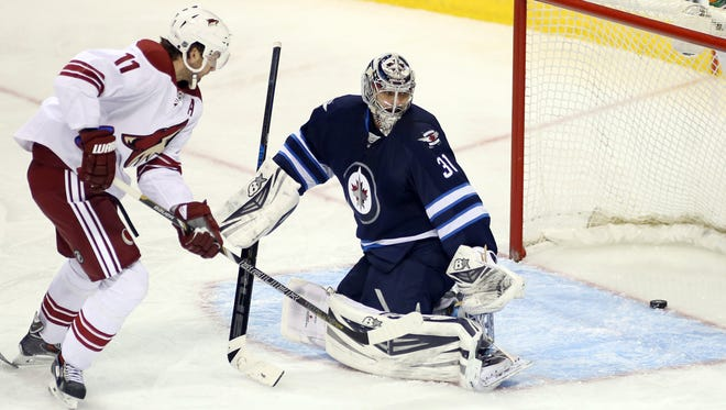 Coyotes forward Martin Hanzal (11) scores against Winnipeg goalie Ondrej Pavelec (31) during the third period at MTS Centre on February 27, 2014.