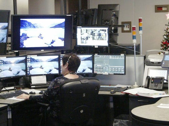 A dispatcher monitors calls at the new combined dispatch center on Dec. 9. The dispatch consoles have multiple screens to monitor radio traffic, emergency calls, and other real-time data.