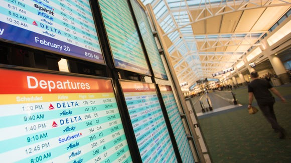 A departure board at Oregon's Portland International