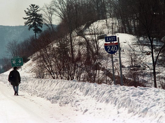 A pedestrian walks along Interstate 240 in Oakley after the Blizzard of '93 passed through. Walking was the only means of transportation for many.