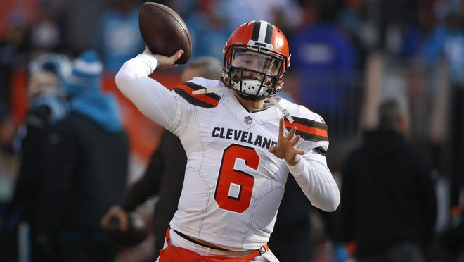 FILE - In this Dec. 9, 2018, file photo, Cleveland Browns quarterback Baker Mayfield warms up before an NFL football game against the Carolina Panthers, in Cleveland. As Baker Mayfield threw passes to his receivers and backs before Sunday's game against Carolina, Browns interim coach Gregg Williams knew his rookie quarterback was going to have a good game. It wasn't anything Williams saw. It was a sound.