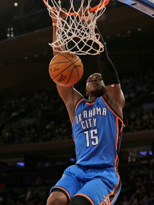 Oklahoma City Thunder guard Reggie Jackson dunks the ball during the first half of NBA basketball game against the New York Knicks, Wednesday, Jan. 28, 2015 at Madison Square Garden in New York.