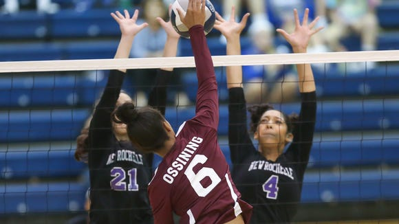 Ossining's Mychael Vernon (6) hits a kill shot as New