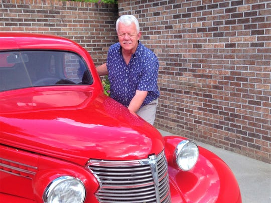 Antique car restoration is one of Ron Williams' hobbies. A cherry 1938 Chevy Coupe is one of his recent projects.