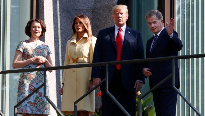Jenni Haukio, wife of Finnish President Sauli Niinisto, U.S. First Lady Melania Trump and President Trump and Finnish President Sauli Niinisto, from left, on the balcony of Niinisto's official residence in Helsinki on Monday.