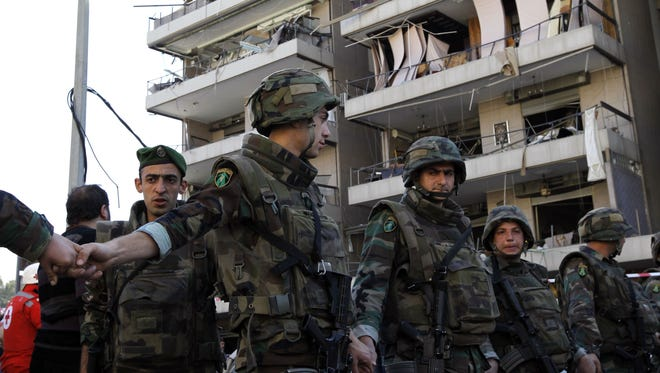Lebanese security forces cordon off the site of an explosion in Beirut's southern Bir Hassan suburb, on February 19. The jihadist Abdullah Azzam Brigades, an Al-Qaeda-inspired group, claimed a double bombing that killed at least four people near an Iranian cultural centre in Lebanon's capital Beirut.  It has issued an apology for civilian deaths.