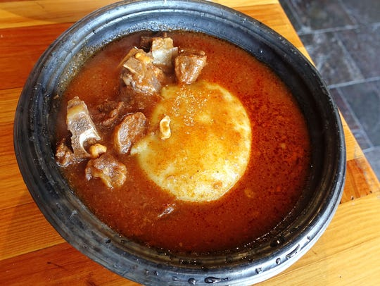Goat soup with fufu at Jollof King in Tempe, AZ.