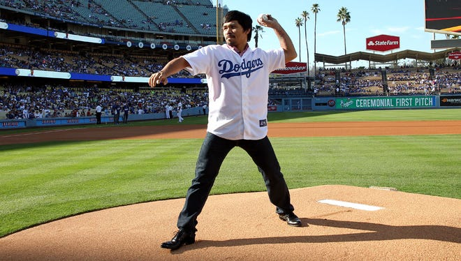 Superstar Manny Pacquiao throws out the 1st pitch at Dodger Stadium before the Los Angeles-Washington Nationals game on Monday, 'Day 8'  of his worldwide tour with  New York's undefeated (20-0) WBO Jr. Welterweight champion Chris Algieri.